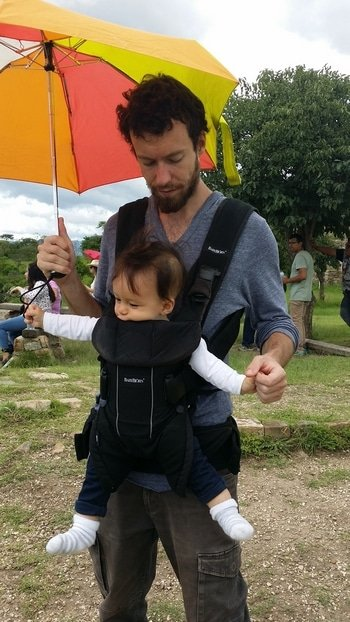Maxime is carrying Darian in the carrier.