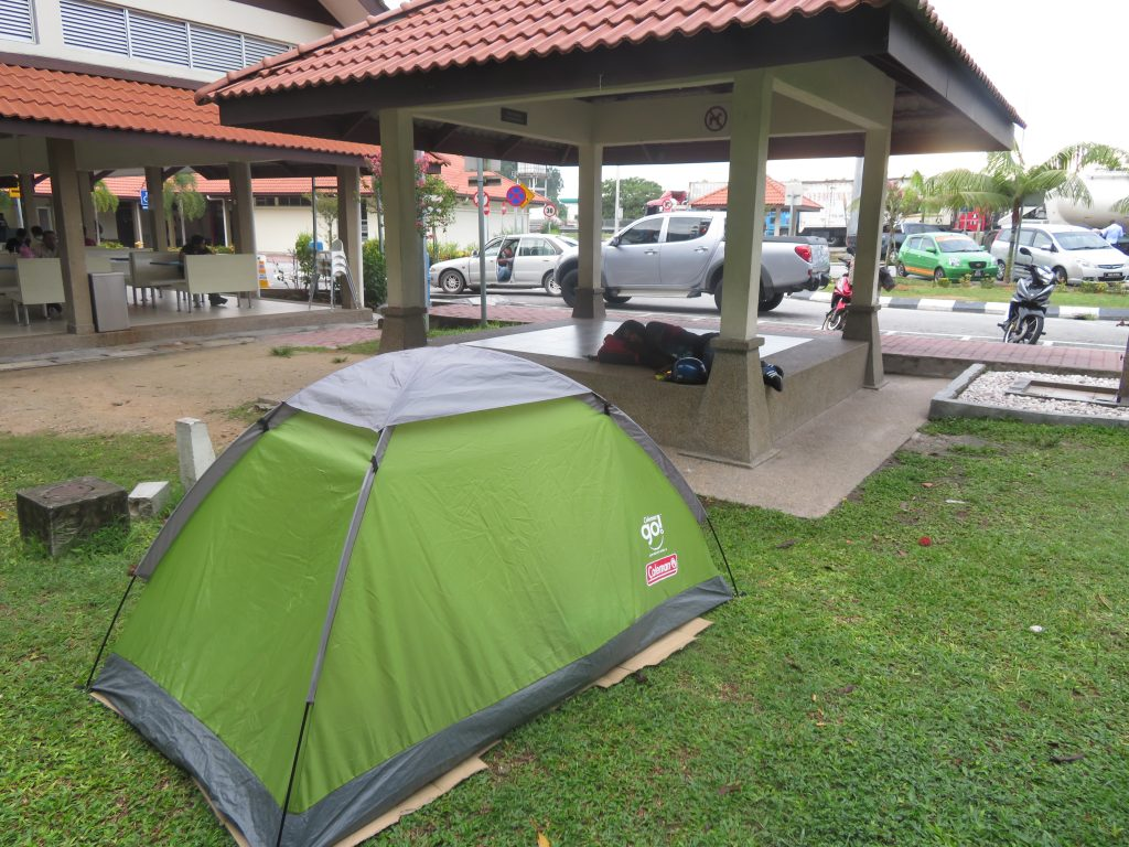 A tent in a gas station on the highway
