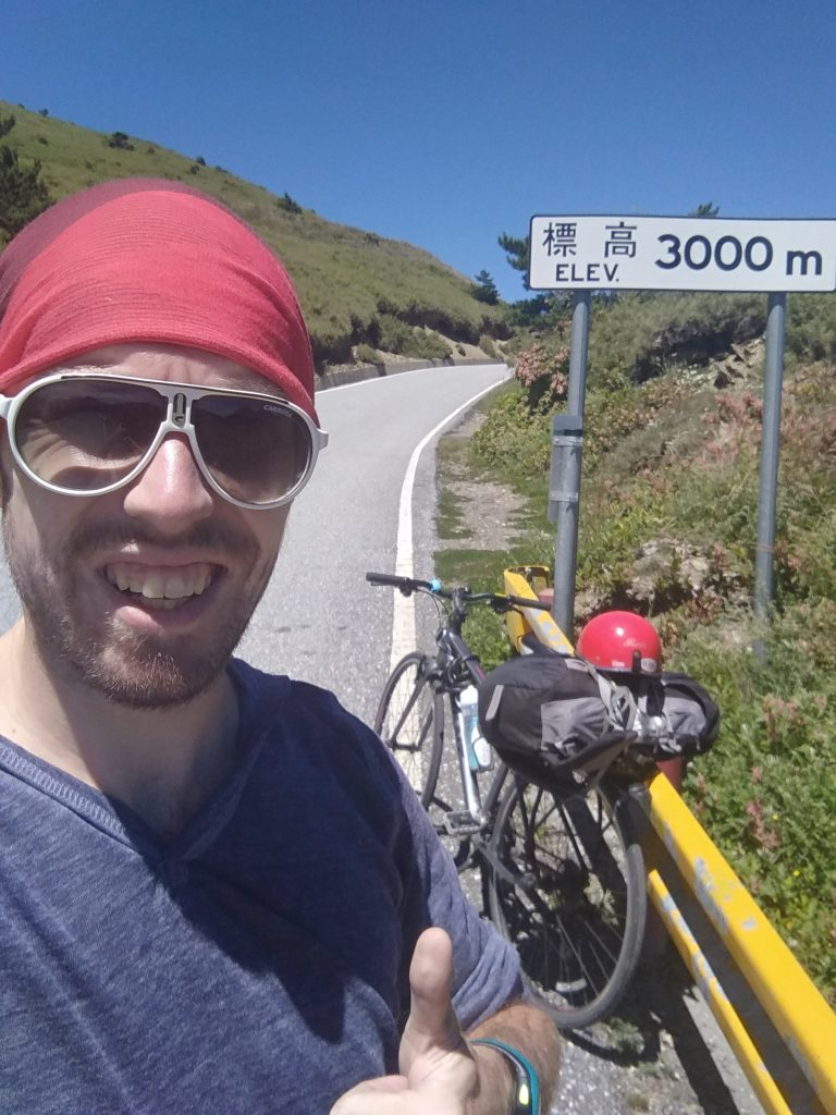A selfie in front of the 3.000 meters elevation on the Central Cross-Island Highway