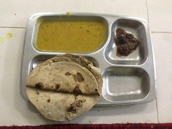 A photo of a free meal in a Sikh Temple with Chapati