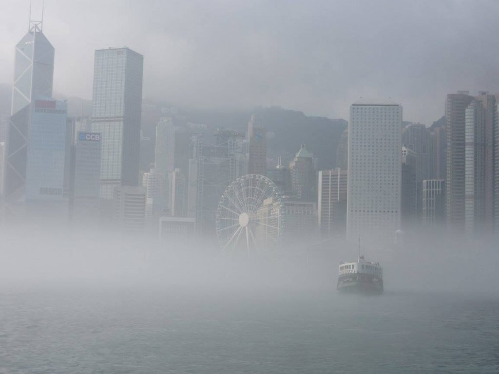 A ferry crossing the Victoria Harbor in the mist