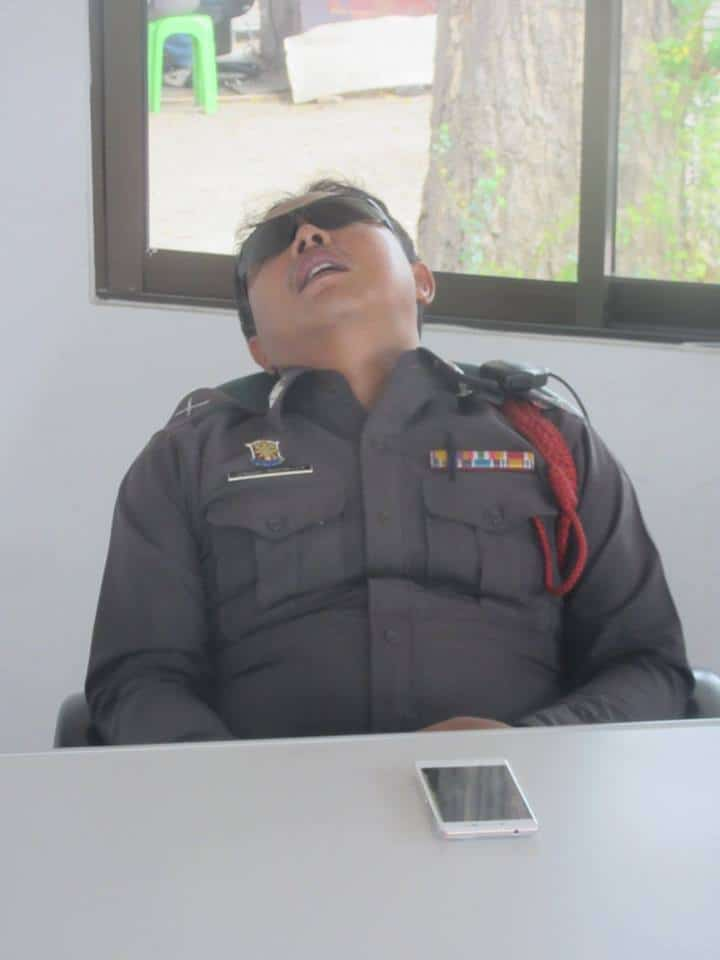 Sleeping Thai policeman