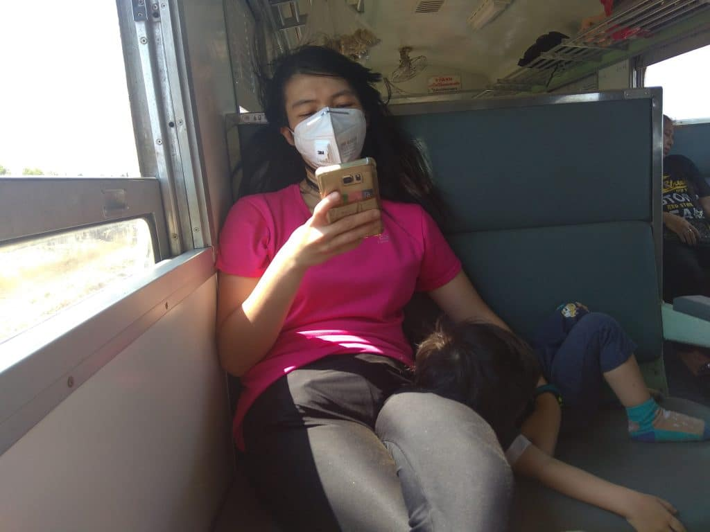 HiuYing in the train in Thailand