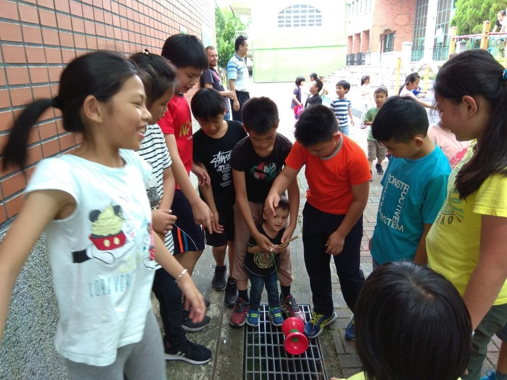 Darian surrounded by Taiwanese kids