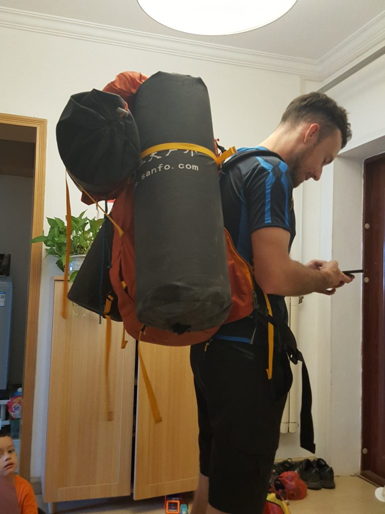 Carrying the tent and mats to go camping on the Great Wall of China !